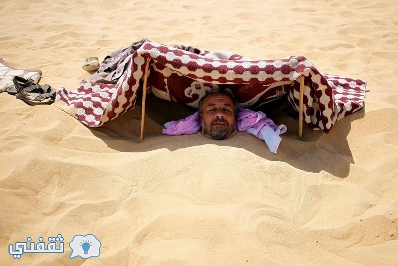 بالصور.. العلاج بالرمال في واحة سيوة (1)