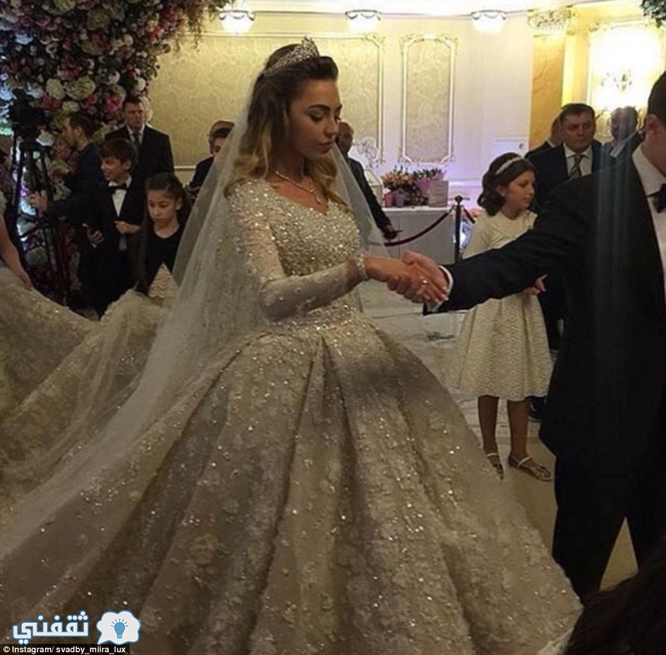 32A7142200000578-3514779-Khadija_s_dress_was_imported_from_Paris_and_reportedly_weighed_2-a-10_1459301110772